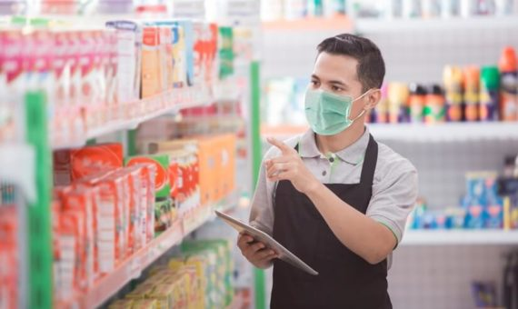 Retail store worker checking stock